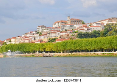 Beautiful old town of portuguese Coimbra located along the Mondego River. On the top of the hill we can find famous University of Coimbra with dominant bell tower. Photo: Sep 4th 2018