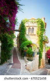 beautiful old town street of Provence with summer flowers, France, retro toned
