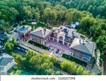 Beautiful old villa garden from above, green garden. Top view of luxury country house