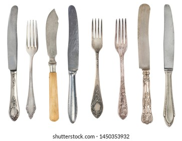 Beautiful old vintage fork and knife isolated on white background. Top view. Retro silverware.