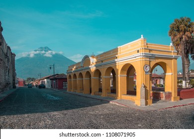 The beautiful old washing station in Antigua Guatemala with Volcan de Agua in the background.
