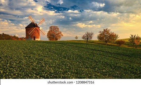 Beautiful old windmill in autumn time. Landscape photo with architecture at sunset (golden hour). Chvalkovice - Czech Republic - Europe.