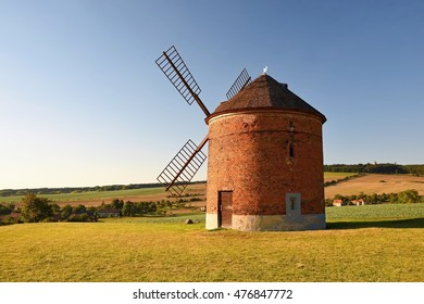 Beautiful old windmill and landscape with the sun. Chvalkovice - Czech Republic. Europe.