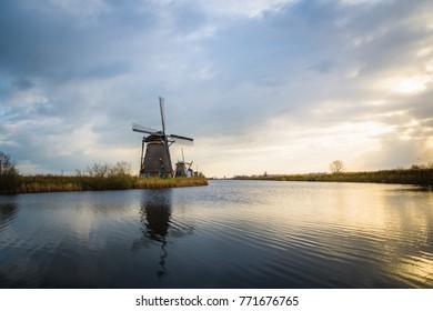 Beautiful old windmills in Kinderdijk. Autumn morning in Holland, Netherlands.