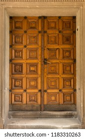 Beautiful old wooden ancient door with wall background, close-up