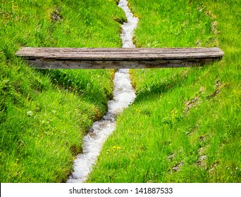 beautiful old wooden bridge at a forest