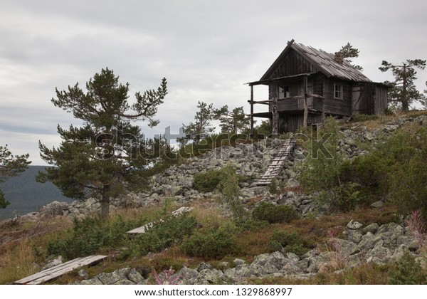 Beautiful old wooden cottage on the top of Levitunturi fell on autumn. This cabin is near of ski slopes and it is very popular place for tourist to take photos