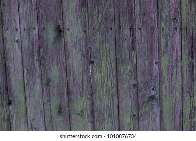 Beautiful old wooden fence with peeling paint texture background