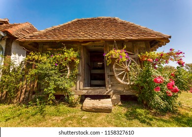 Beautiful old wooden Serbian house in Vrdnik with flowers outdoors