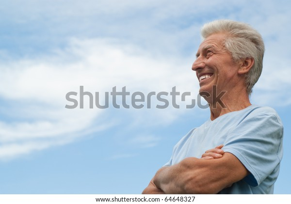 beautiful older man stands on the sky
