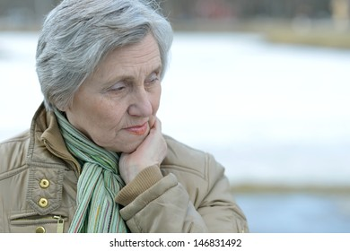 beautiful older woman on a walk outdoors in spring