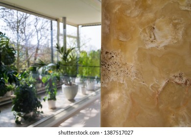 Beautiful onyx stone natural texture patterns, design wall, modern architecture, white, yellow and brown colors