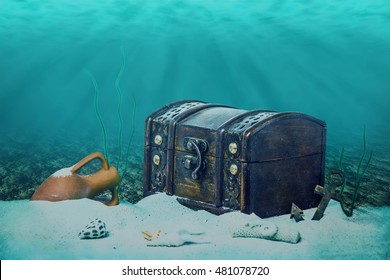 beautiful opened empty old wooden treasure chest submerged underwater world with anchor, amphora and light rays, close up