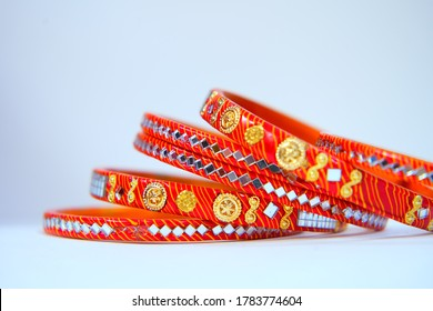 Beautiful orange Indian bangles with mirrors, Indian, traditional  wedding bangles, Beautiful bangles, isolated on white background, Colorful bangles, for women.