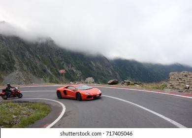 Beautiful orange Lamborghini Huracan drived on Transylvania region on the famous Transfagarasan road. Romania 22 August 2017