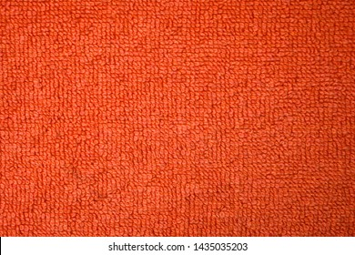 A beautiful orange natural-cotton towel background. Closeup of the grapefruit colored soft fiber texture.