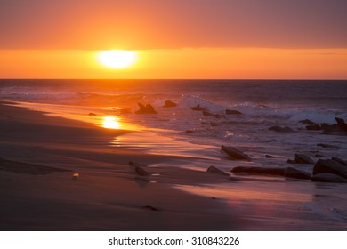 Beautiful orange purple sunset on the beach of Punta Sal, near Mancora, Peru.