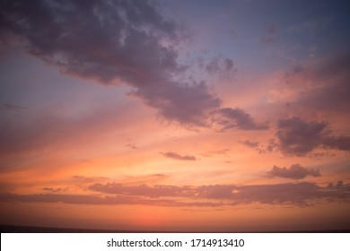 beautiful orange sky with clouds on a sunset in ikaria