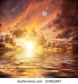 Beautiful orange sun rise with sea and clouds