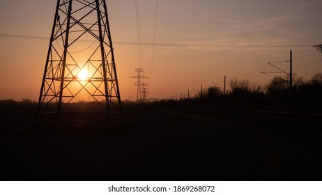 Beautiful orange sunset with eletric pole on the edge of the Bratislava