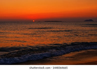 A beautiful and orange sunset over Mediteranean Sea somewhere in Crete Island.