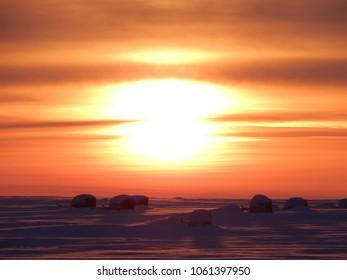 Beautiful orange sunset in Russian tundra on Yamal