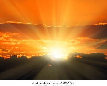 beautiful orange sunset with sunbeams and dark clouds