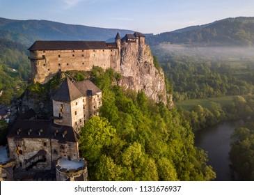 Beautiful Orava castle in Oravsky Podzamok in Slovakia.  Morning misty landscape.