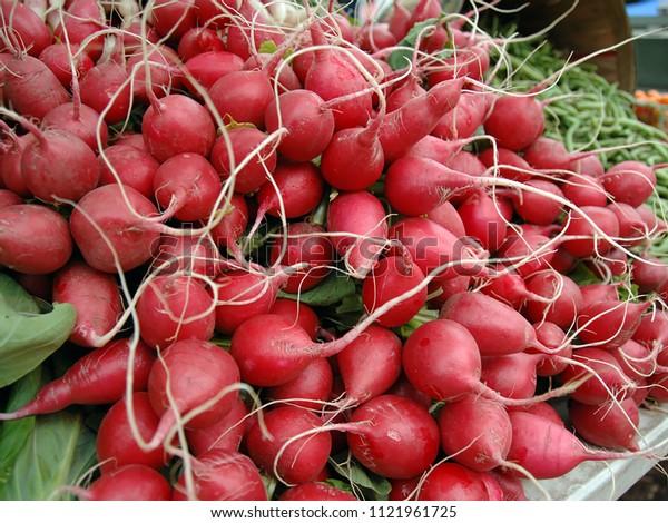 beautiful organic radishes at a farmers market