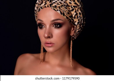 beautiful oriental girl in leopard style. Leopard clothing. Beautiful smoky makeup. Charming woman. Chalm on the head. long eyelashes