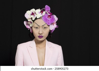 Beautiful Oriental Girl with Orchid Flowers