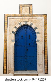 Beautiful ornamental blue door of so typical shape for Tunisia