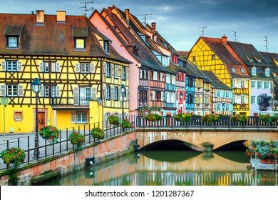 Beautiful ornamental walkway with traditional colorful houses, Colmar, France, Europe