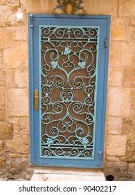 Beautiful Ornamented decorative blue iron door gate Jerusalem The Old city