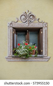 A beautiful ornamented window with flowers in Andalo village, Trentino, North Italy