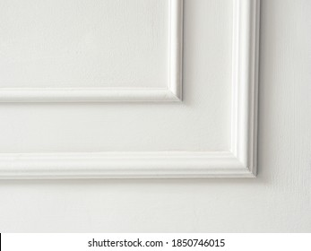 Beautiful ornate white decorative mouldings in studio. Decorative stucco in the classic interior of the house. The angle of the frame molding white for clipart. White cement plaster wall background. - Shutterstock ID 1850746015