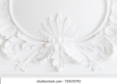 Beautiful ornate white decorative plaster moldings in studio