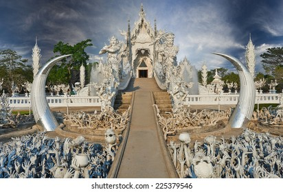 Beautiful ornate white temple located in Chiang Rai northern Thailand. Wat Rong Khun (White Temple), is a contemporary unconventional Buddhist temple.Buddhist and Hindu motifs.