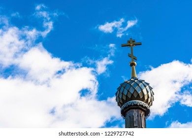 Beautiful Orthodox church dome with a cross on a background of the cloudy sky, Russia.