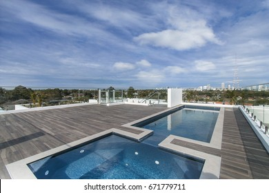 Beautiful outdoor pool on the roof. With wooden floor