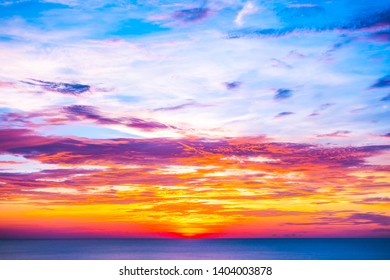 Beautiful outdoor tropical nature landscape of sea ocean at sunrise or sunset with sky and cloud background