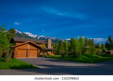 Beautiful outdoor view of gorgeous wooden mixed classic house buiding, located in a neighborhood in Yellowstone