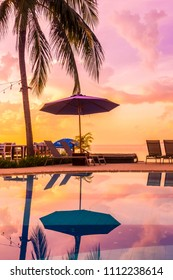 Beautiful outdoor view with umbrella and chair around swimming pool in luxury hotel and resort at sunrise time for travel and vacation