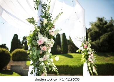 Beautiful outgoing wedding set up. Jewish Hupa  on romantic wedding ceremony , wedding outdoor on the lawn. Wedding decor. A pink box for presents in the shape of a heart is on the table.