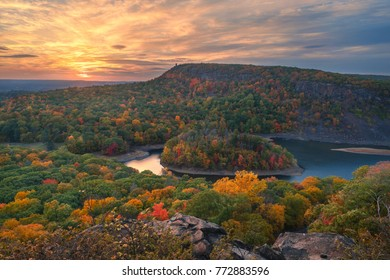 Beautiful overlook of a lake and an island in the peak of fall foliage color