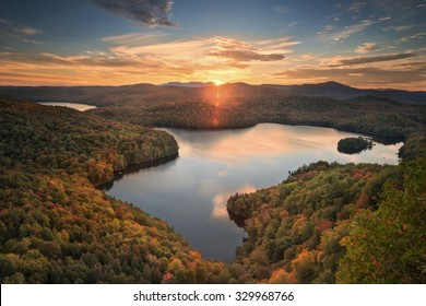 beautiful overlook of Nichols pond in Vermont in the fall