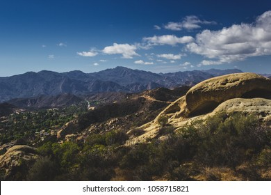 Beautiful overlook of Red Rock Canyon and rock formations on a sunny day with blue sky and clouds, Red Rock Canyon Park, Topanga, California