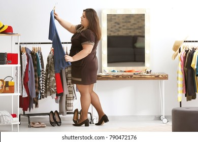 Beautiful overweight woman shopping in boutique