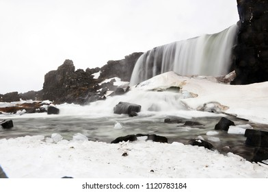 Beautiful Oxarafoss waterfall with snow in winter in Thingvellir national park, Iceland