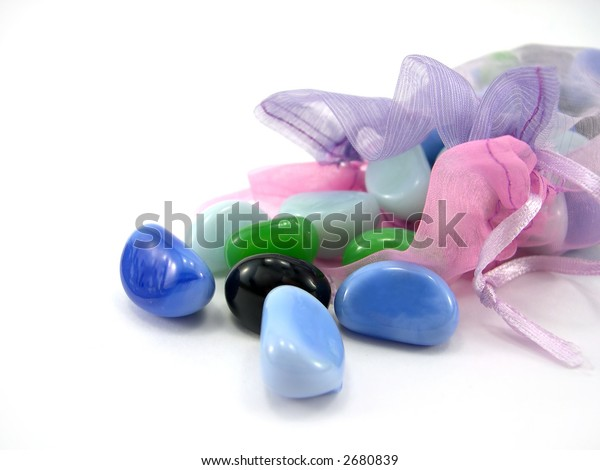 Beautiful package with decorative stones on a white background